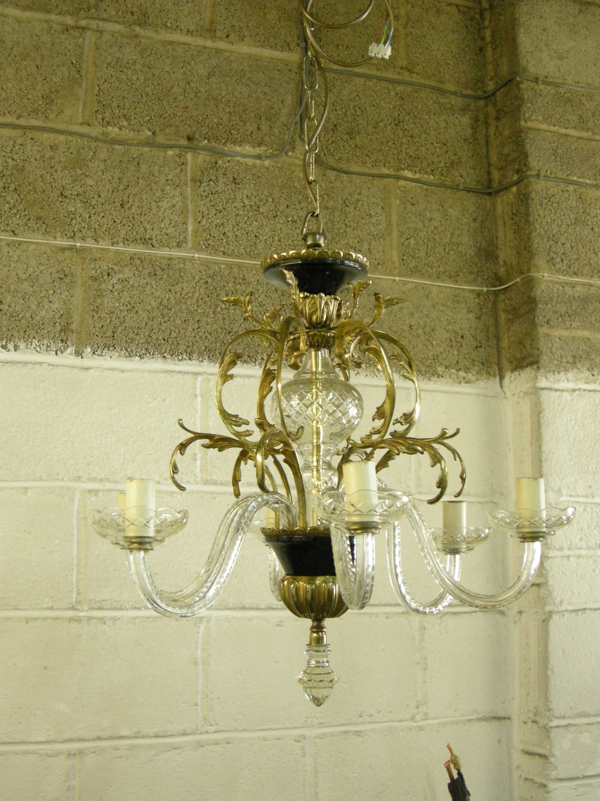 glass and brass chandelier after restoration