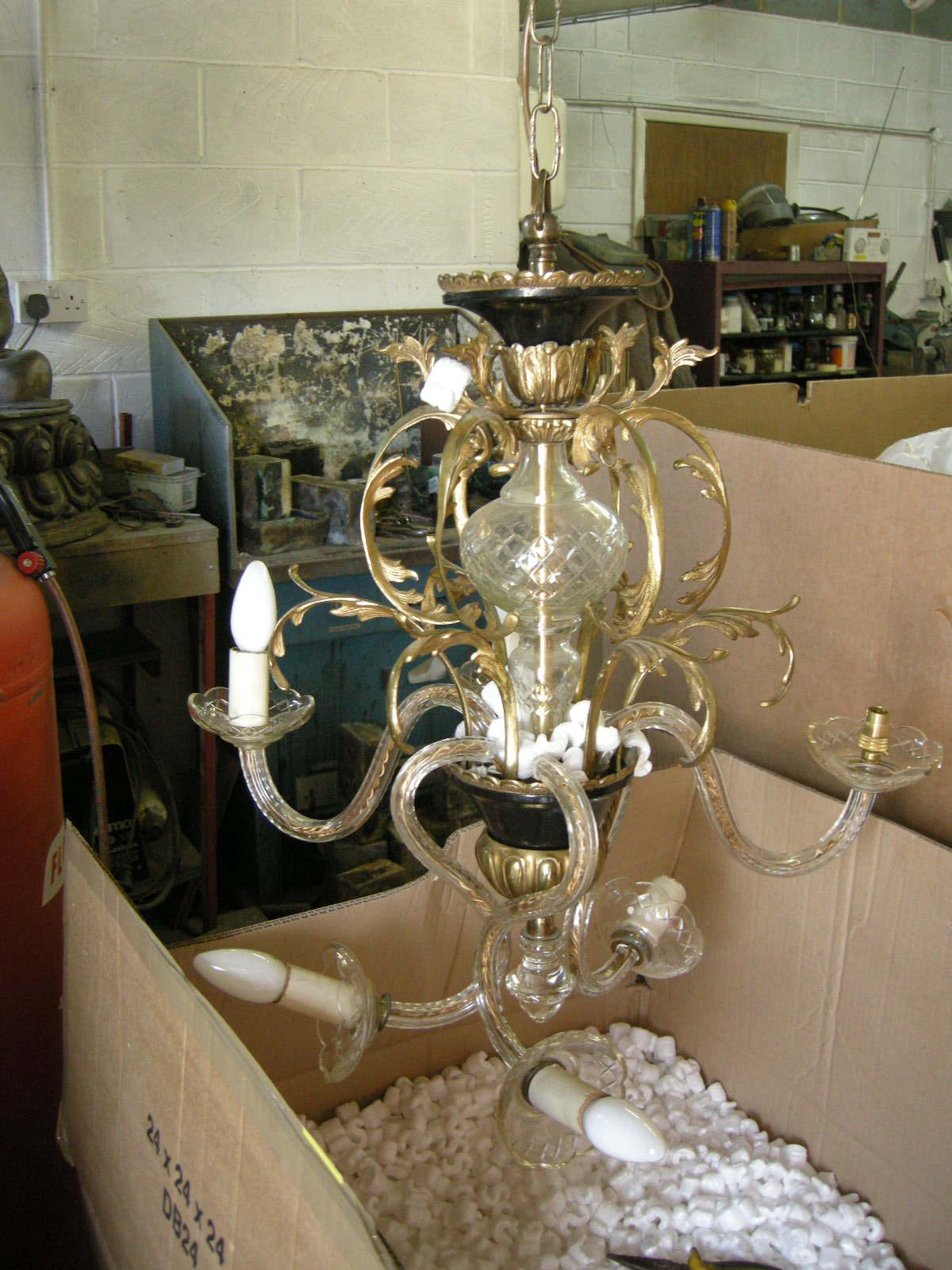 glass and brass chandelier before restoration