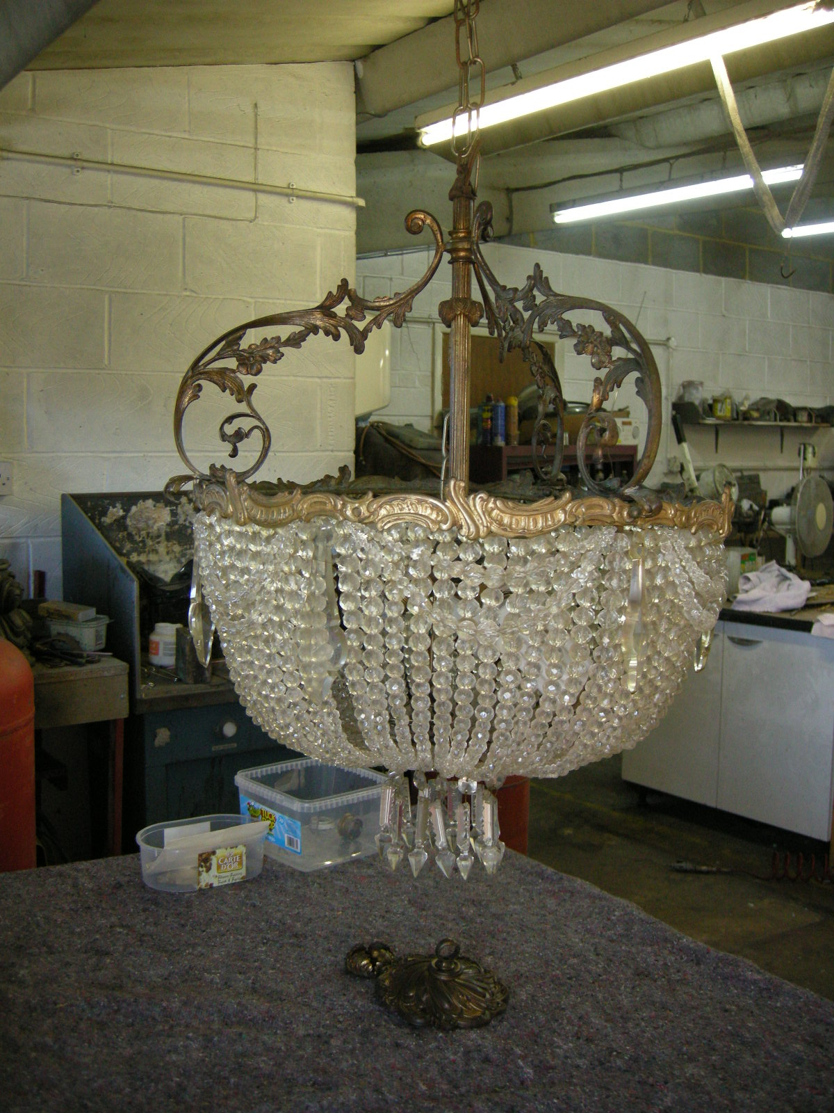 brass and glass chandelier before restoration