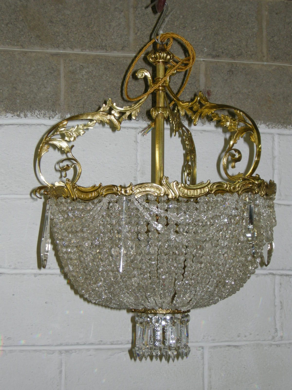brass and glass chandelier after restoration